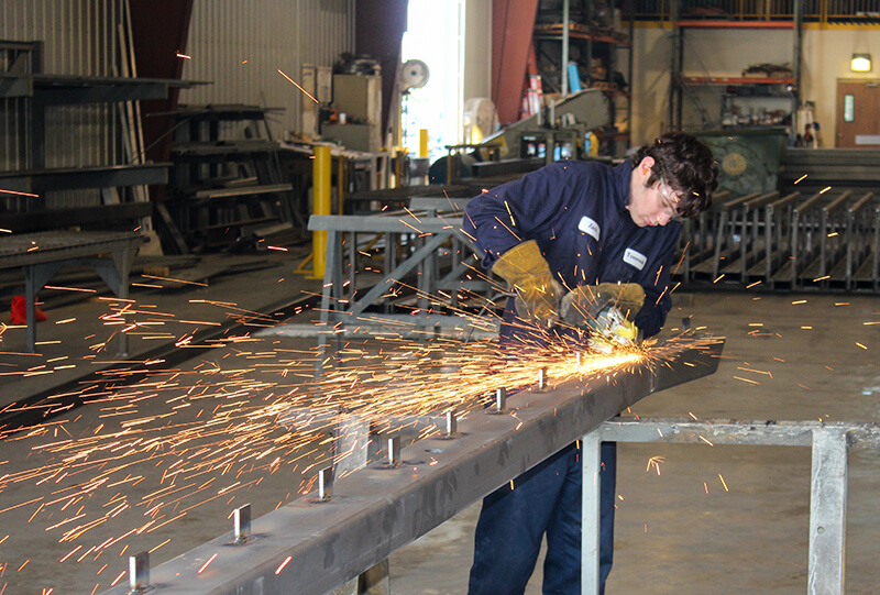 Tomrook Steel fabrication cleaning up welds